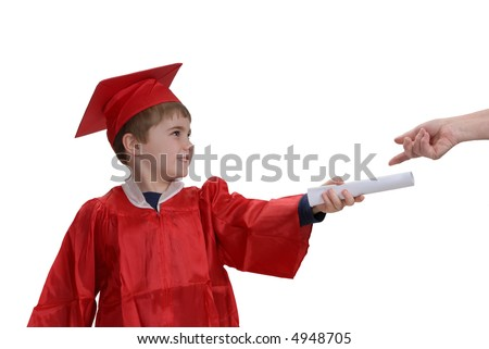 Young boy, in red graduation gown and hat, holding the diploma he just received - stock photo
