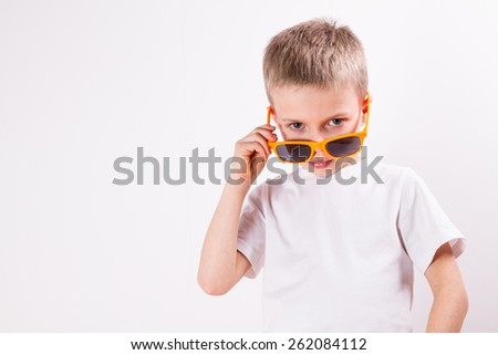 Young boy in sunglasses - stock photo