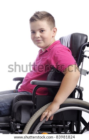 young boy in wheelchair . isolated on white background - stock photo