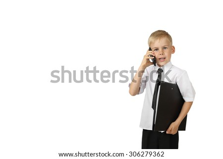 Young boy in white shirt and black tie with big folder in hand talk on cell phone isolated on white background with copy space for text or advertising - successful business concept - stock photo