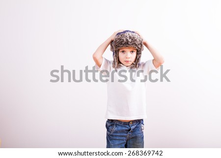 young boy in winter hat - stock photo