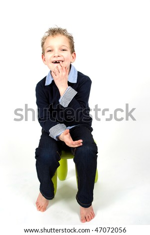 Young boy is pointing at his mouth. - stock photo