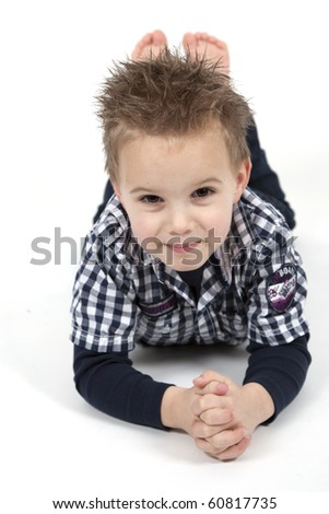 Young boy is posing for the camera - stock photo
