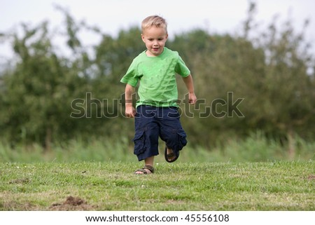 Young boy is walking in the park.