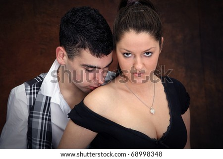 young boy kissing girl