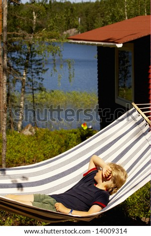 Young Boy Laying on a Hammock - stock photo