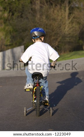 Young Boy Learning to Ride a Bike