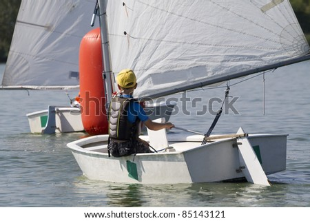 young boy learning to sail - stock photo