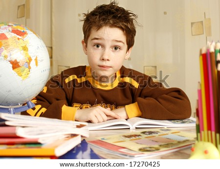 young boy learns to spell - stock photo