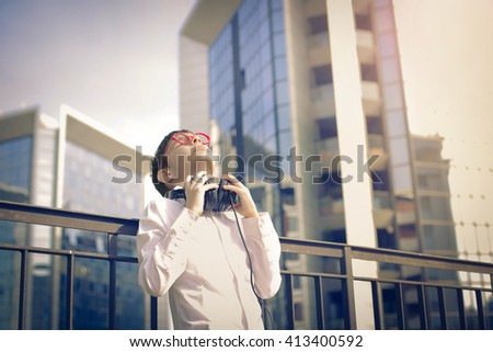 Young boy listening to music - stock photo