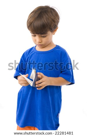 Young Boy looking at his passport . - stock photo