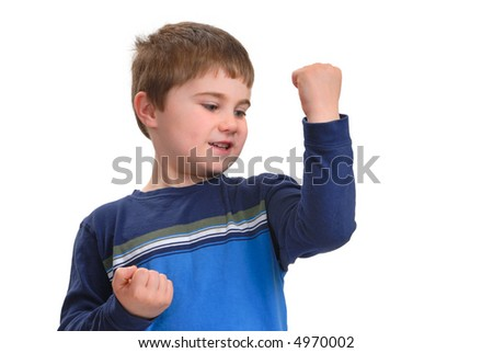 Young boy looking at how well his muscles are growing, isolated on white