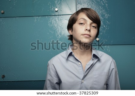 Young boy looking at the camera - stock photo