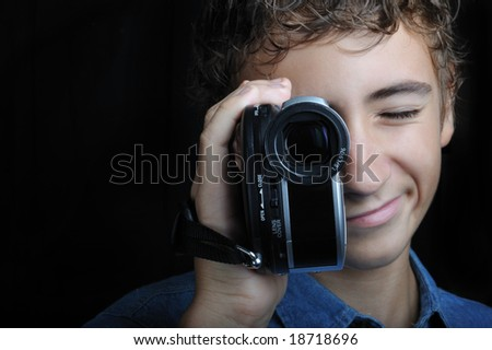 Young boy looking through a handholding camera - stock photo