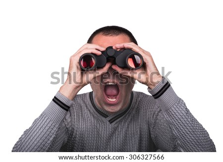 Young boy looking through binoculars, and opened his mouth in surprise on a white background