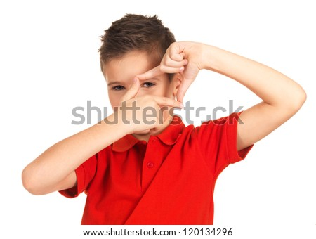 Young boy looking through frame shape made by hands - isolated on white background - stock photo