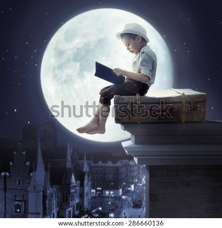 Young boy on a roof - stock photo