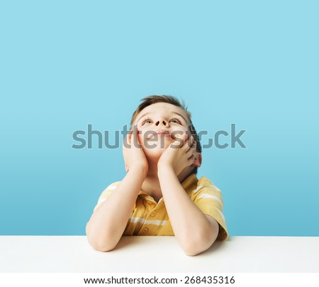 Young boy on blue background - stock photo