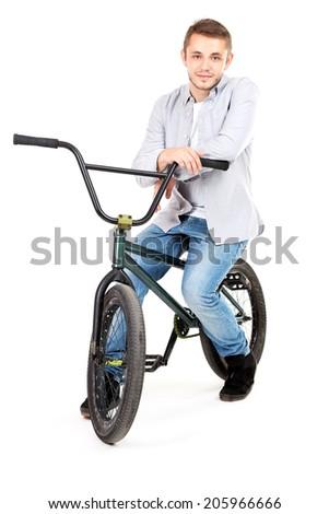 Young boy on BMX bike isolated on white - stock photo