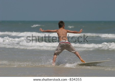 young boy on boogie board