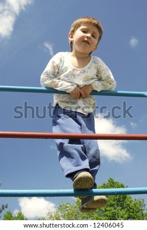 Young boy on metal playstructure