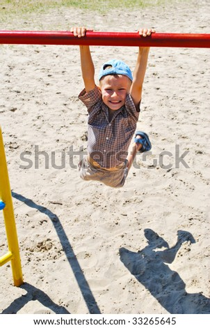 Young boy on play structure - stock photo