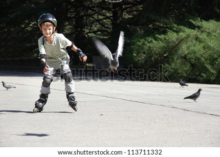 young boy on roller skates outdoors - stock photo