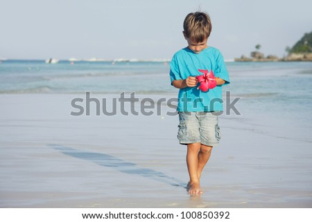 young boy on sand beach - stock photo