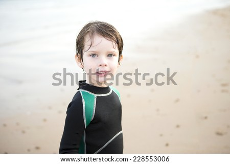 Young Boy on the Beach wearing a Wetsuit