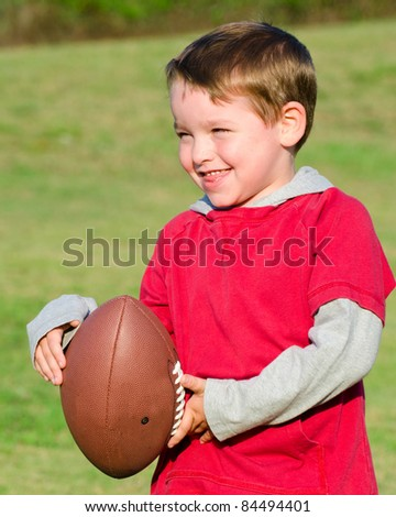 Young boy or kid with football - stock photo