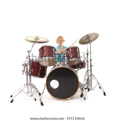 young boy playing drums against white background - stock photo