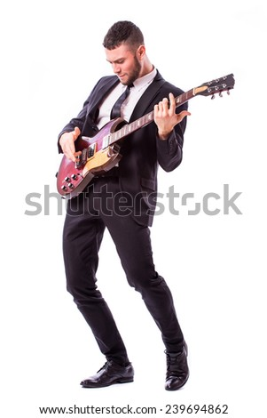 young boy playing guitar  - stock photo