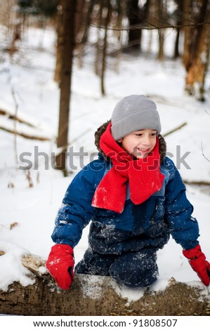 young boy playing outdoors in winter