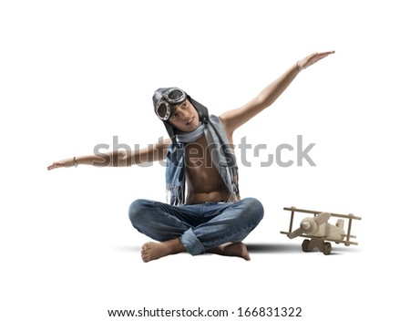 Young boy playing with toy airplane on white background - stock photo