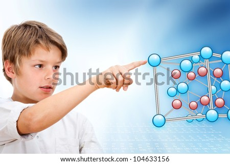 Young boy pointing at 3D molecules in futuristic interface.