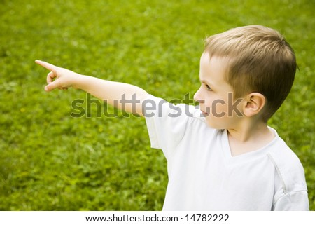 Young Boy Pointing Out Something - stock photo