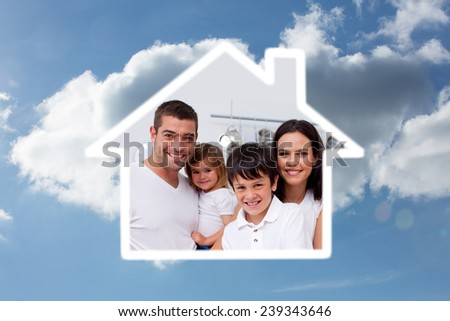 Young boy preparing food with his family against cloudy sky - stock photo