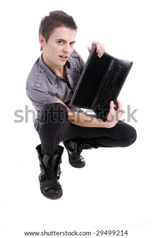 Young boy presenting new laptop, isolated on white