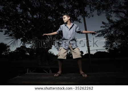 Young boy pretending to surf on a table