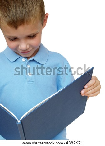 young boy reading a picture book - stock photo