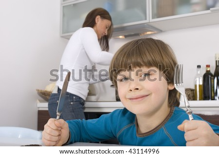 Young boy ready to eat - stock photo