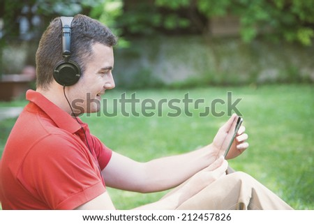 young boy relaxing with tablet - stock photo