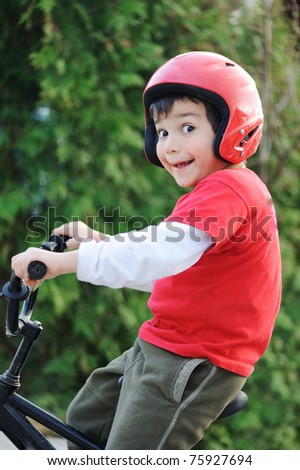 Young boy riding bicycle, shallow dof - stock photo