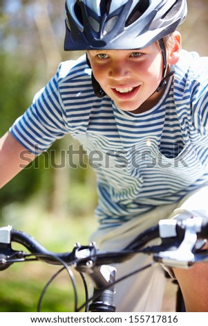 Young Boy Riding Bike Along Country Track