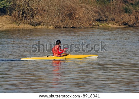 Young boy rowing at river Lima near Ponte de Lima in Portugal - stock photo