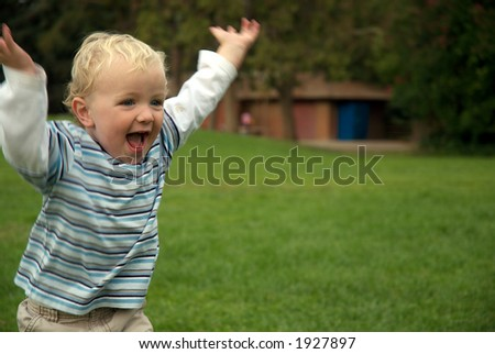 young boy running - stock photo