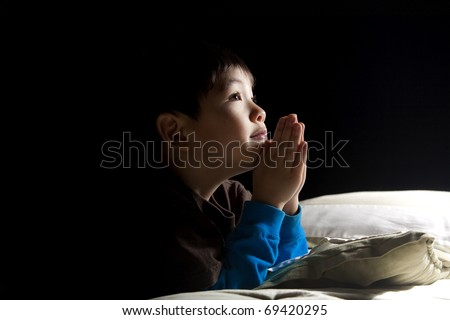Young boy's bedtime prayer. - stock photo