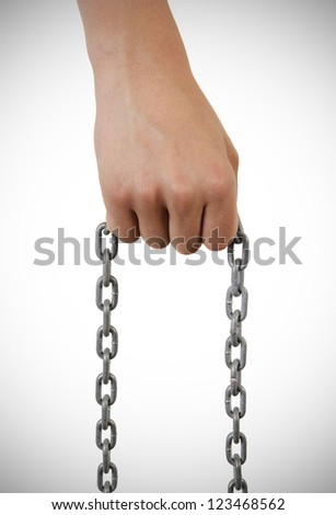 young boy's hand holding a chain. isolated on white background