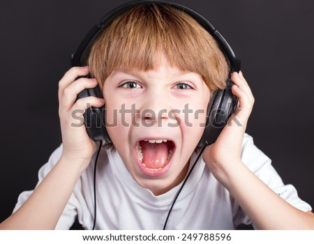 Young boy's singing with headphones - stock photo