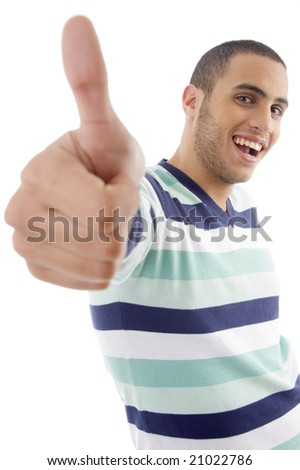 young boy showing thumbs up on an isolated white background - stock photo